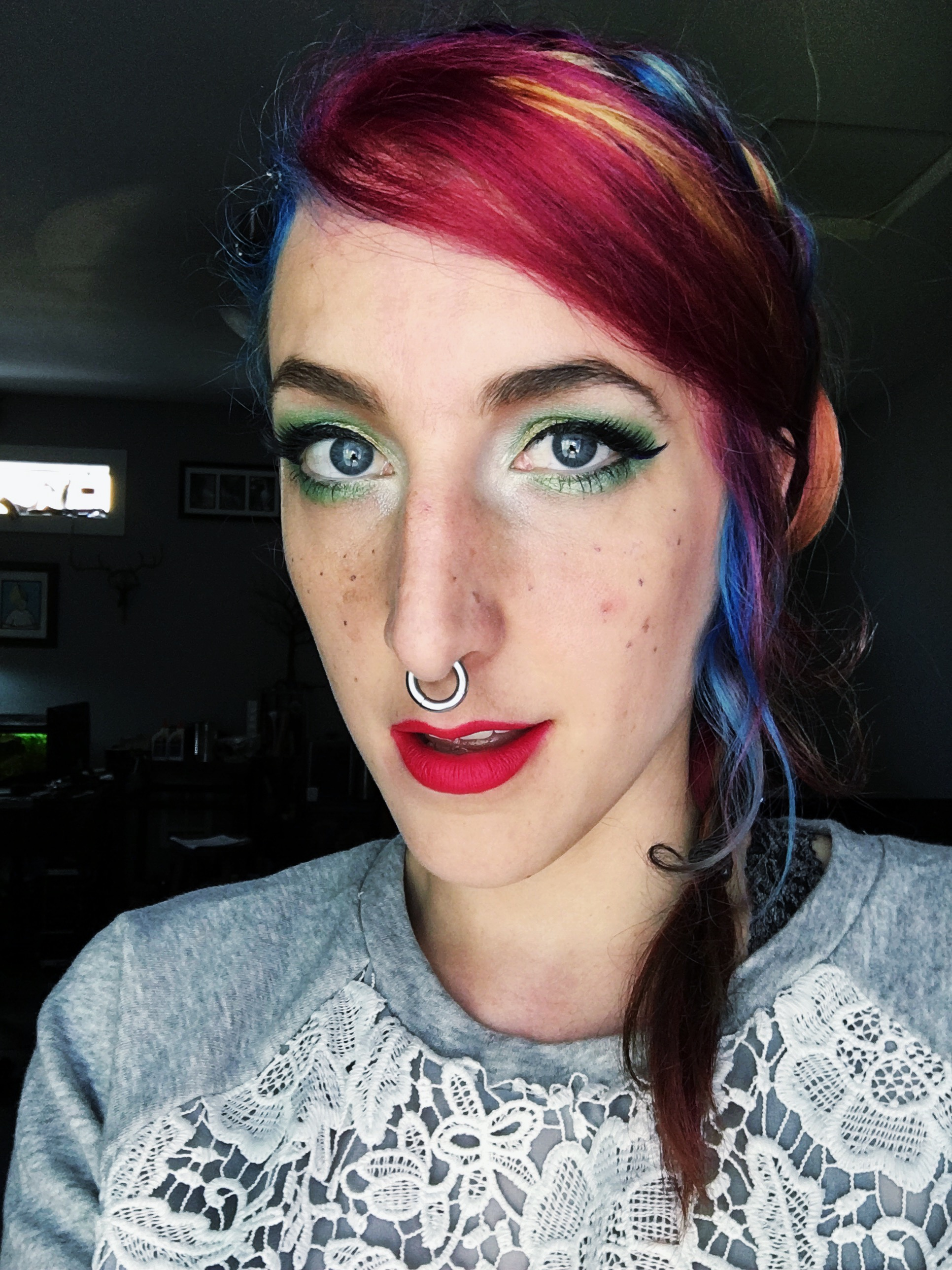 Rainbow hair and green makeup
