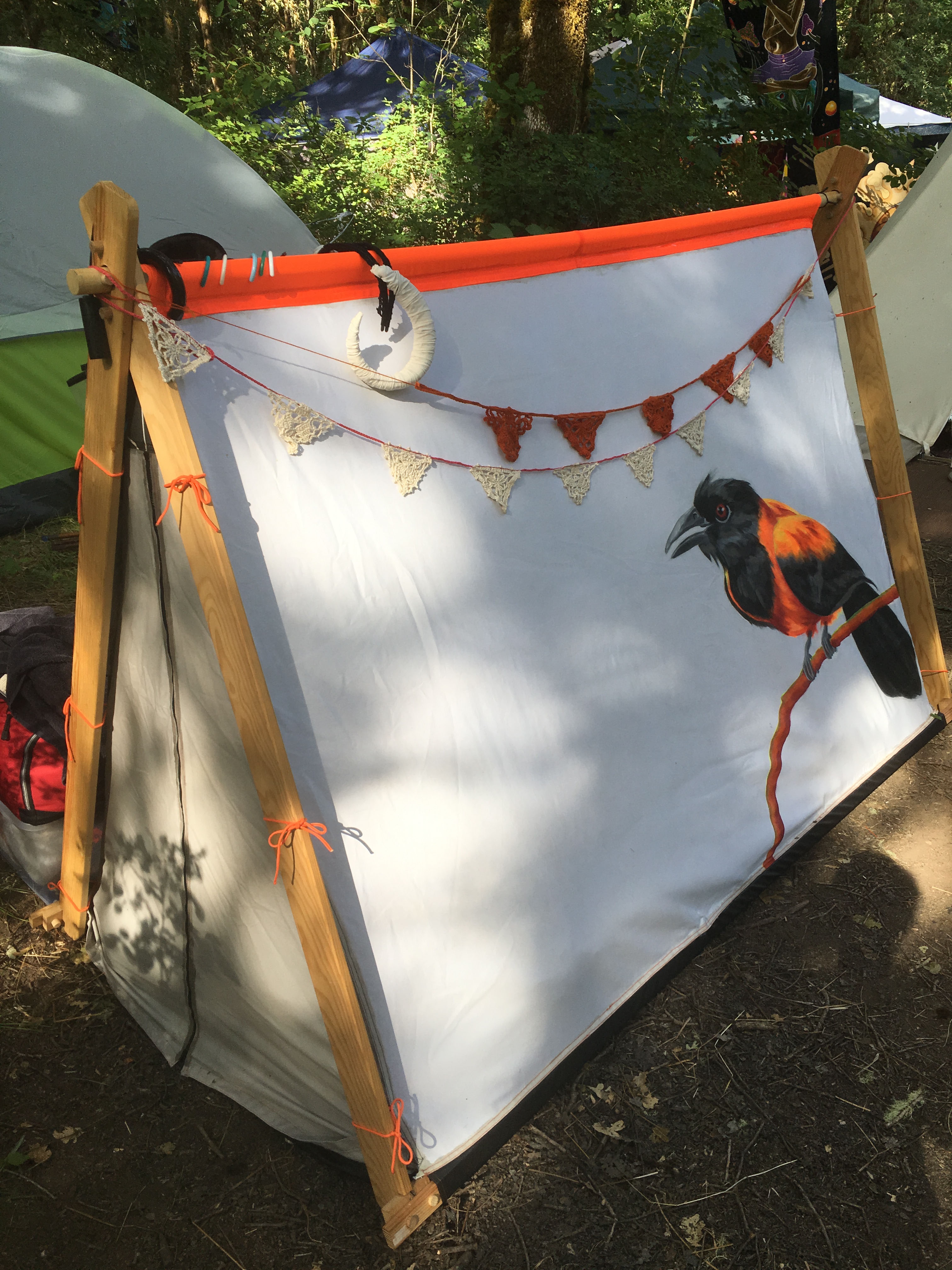 Tent with a bird on it
