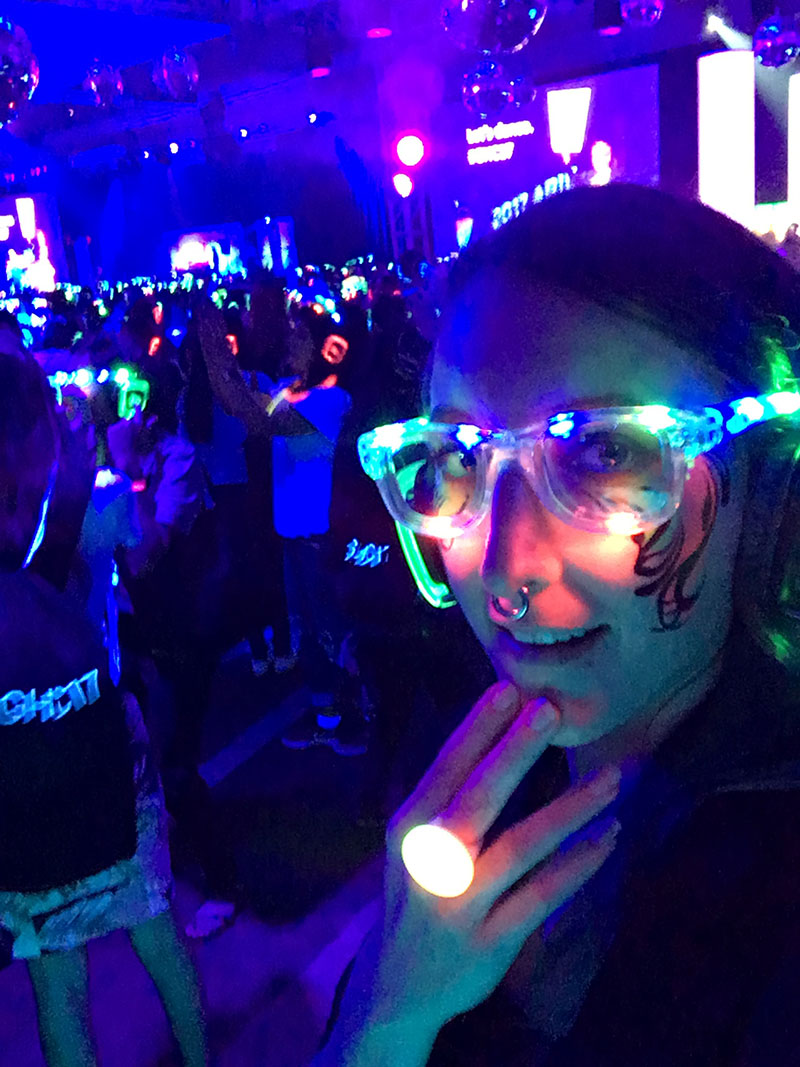 at a sick party with led glasses and uv facepaint